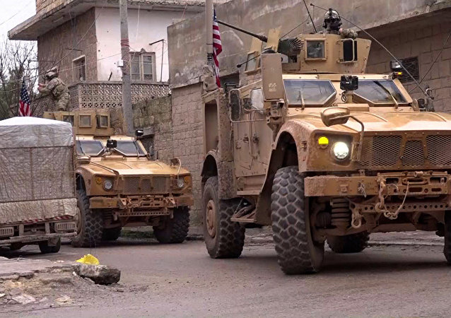 An image grab taken from a video obtained by AFPTV on January 16, 2019, shows US armoured vehicles at the scene of a suicide attack in the northern Syrian town of Manbij