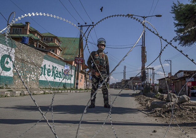 An Indian paramilitary soldier stands guard during a curfew in Srinagar, Indian controlled Kashmir, Friday, June 9, 2017