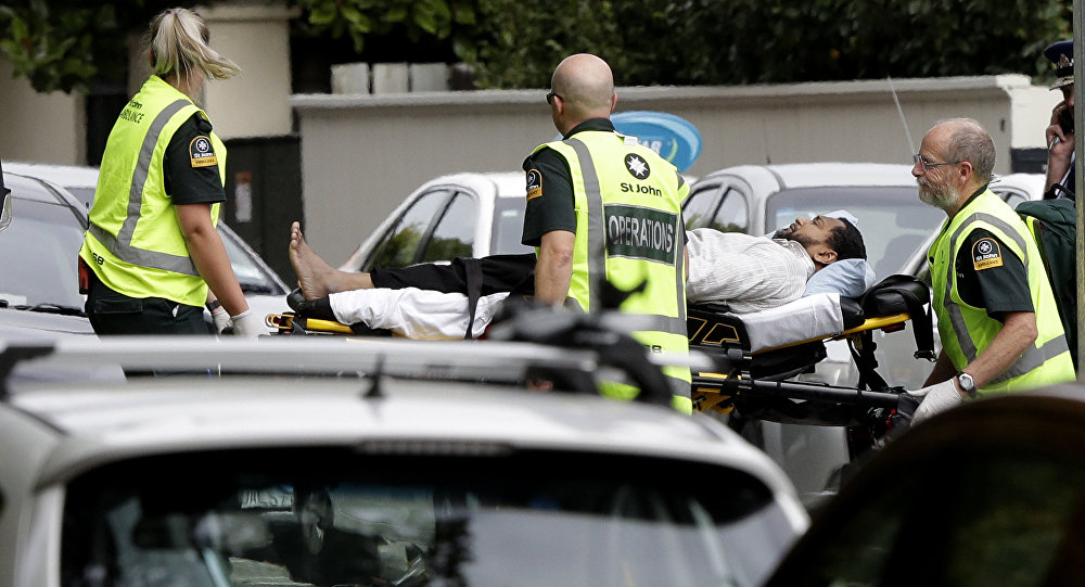 Ambulance staff take a man from outside a mosque in central Christchurch, New Zealand, Friday,