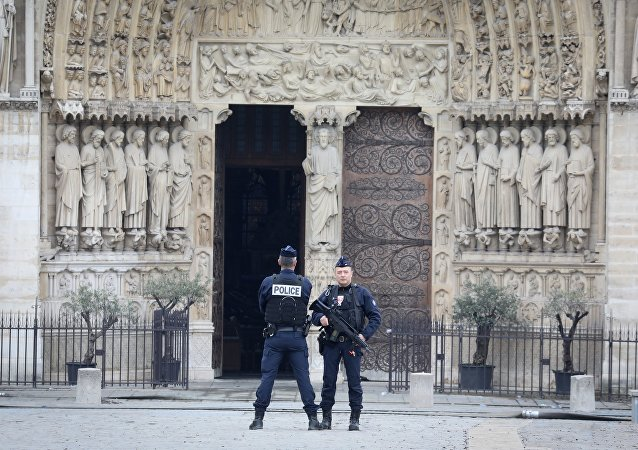French police officers stand outside Notre-Dame-de Paris on April 16, 2019 in Paris in the aftermath of a fire that devastated the cathedral