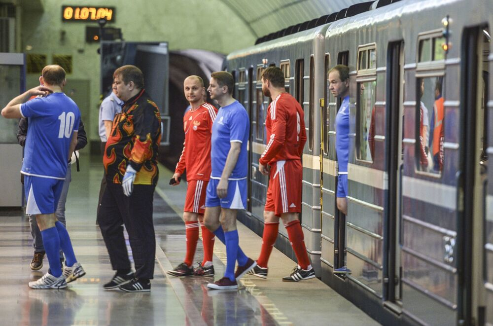 Players before the football match on the International station of the St. Petersburg subway