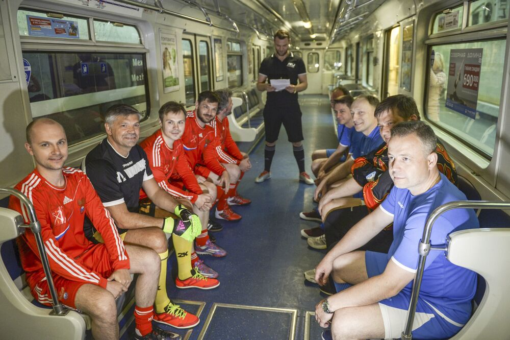 Players in a train before a football match on the station International of the St. Petersburg subway