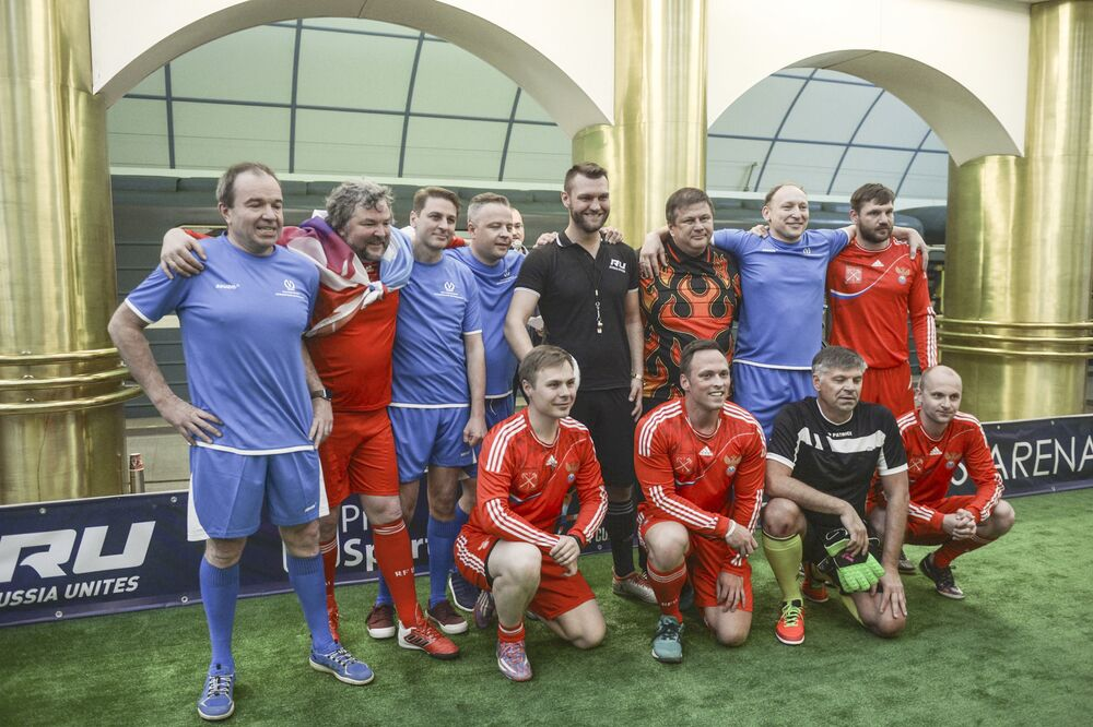 Players after a football match on the platform International of the St. Petersburg subway