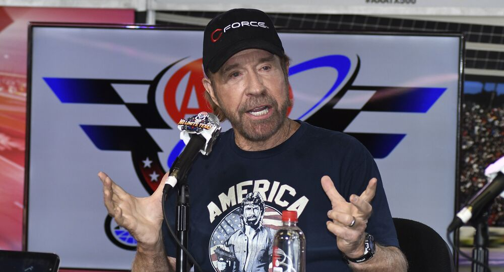 Chuck Norris speaks to reporters during a media availability before the NASCAR Sprint Cup Series auto race at Texas Motor Speedway in Fort Worth, Texas, Sunday, Nov. 6, 2016