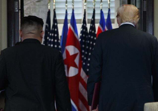 President Donald Trump and North Korean leader Kim Jong Un participate in a signing ceremony during a meeting on Sentosa Island, Tuesday, June 12, 2018, in Singapore