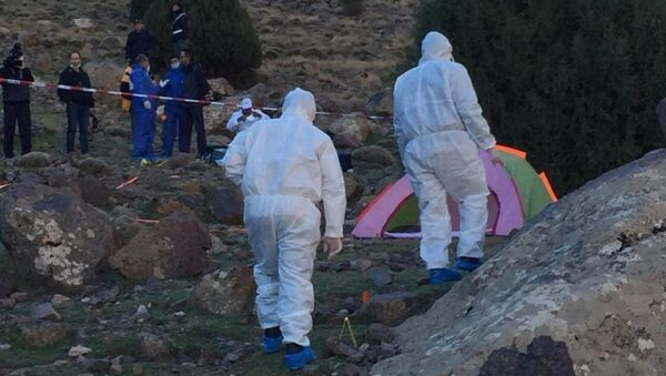 In this photo provided by Moroccan news channel 2M and taken on Tuesday, Dec. 18, 2018, a forensic team is seen at the area where the bodies of two Scandinavian women tourists were found dead, near Imlil in the High Atlas mountains, Morocco - Sputnik Ελλάδα