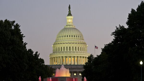 The US Congress building is seen at dusk on the eve of a possible government shutdown as Congress battles out the budget in Washington, DC, September 30, 2013. - Sputnik Ελλάδα