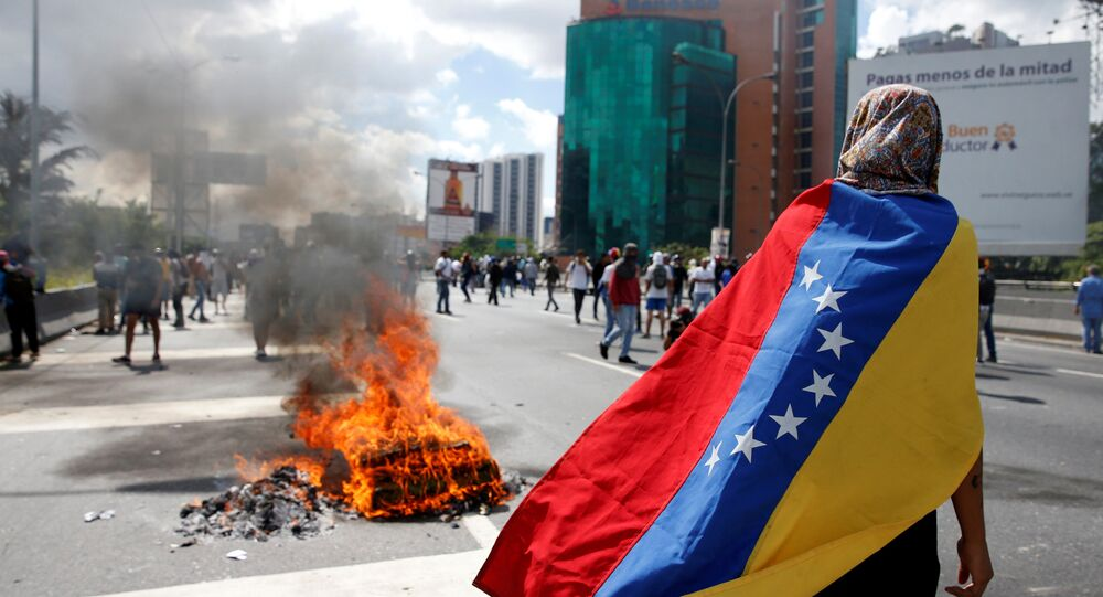 Protesters clash with riot police during a rally to demand a referendum to remove Venezuela's President Nicolas Maduro in Caracas