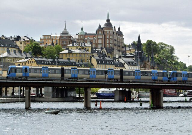 A T-bana (Metro) train passes on a bridge in front of the Sodermalm area of Stockholm