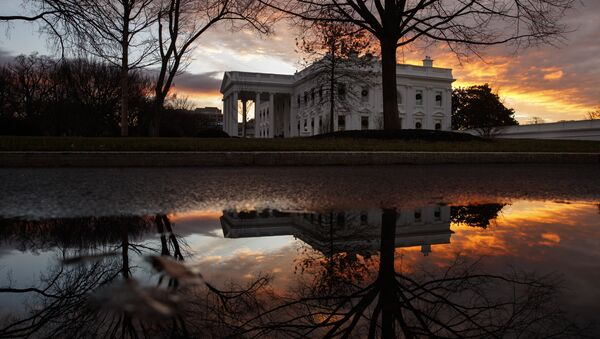 The sun rises behind the White House in Washington, Saturday, Dec. 22, 2018. Hundreds of thousands of federal workers faced a partial government shutdown early Saturday after Democrats refused to meet President Donald Trump's demands for $5 billion to start erecting a border wall with Mexico - Sputnik Ελλάδα