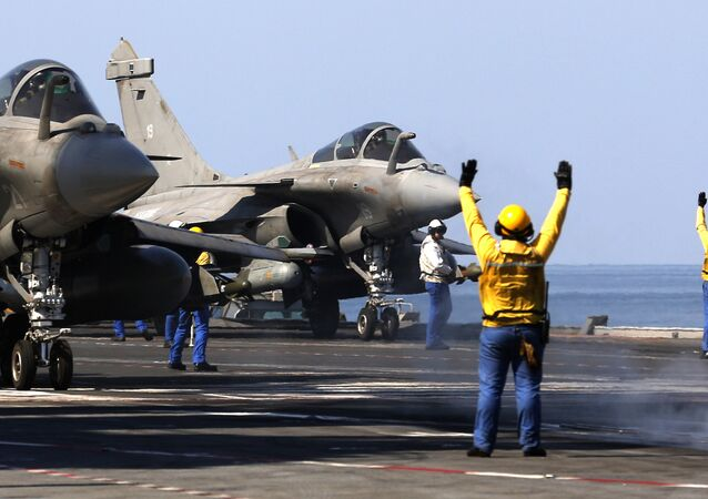 French navy Rafale fighter jets prepare to take off from the aircraft craft carrier Charles de Gaulle operating in the Gulf on February 25, 2015