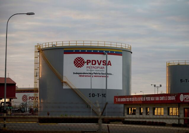 Storage tanks stand in a PDVSA state-run oil company crude oil complex near El Tigre, a town located within Venezuela's Hugo Chavez oil belt, formally known as the Orinoco Belt