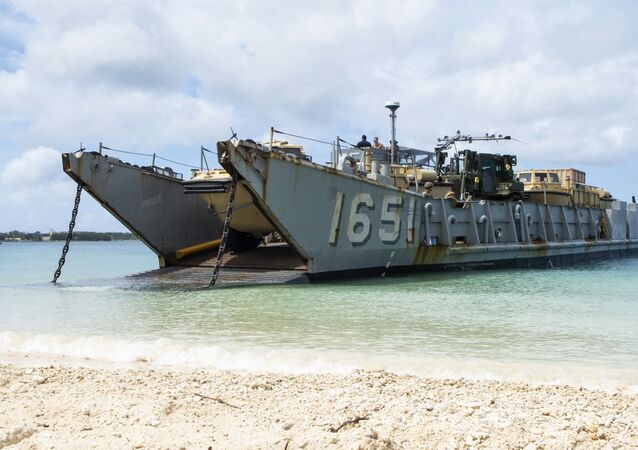 Landing Craft, Utility (LCU) 1651, assigned to Naval Beach Unit (NBU) 7, stands by to retrieve Marines assigned to the 31st Marine Expeditionary Unit (MEU) during a simulated beach raid. The amphibious transport dock ship USS Green Bay (LPD 20), part of the Commander Amphibious Squadron 11, is operating in the region to enhance interoperability with partners and serve as a ready-response force for any type of contingency.
