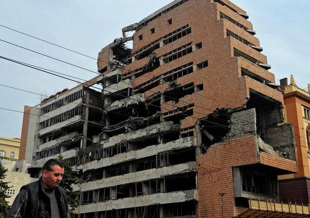 A man walks past the building of former federal military headquarters in Belgrade on March 24, 2010, destroyed during the 1999 NATO air campaign against Yugoslavia.