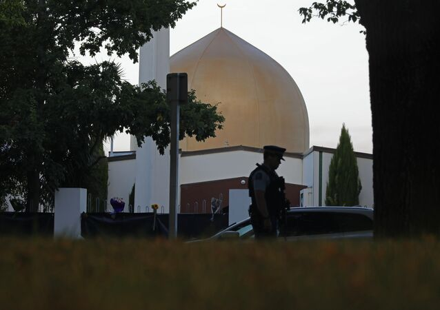 In this March 17, 2019, file photo, a police officer stands guard in front of the Al Noor mosque in Christchurch, New Zealand