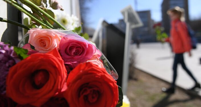 Flowers left at the French embassy in Moscow after the Notre Dame fire