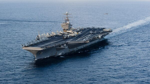 This January 19, 2012 image provided by the US Navy, shows the Nimitz-class aircraft carrier USS Abraham Lincoln (CVN 72) transiting the Arabian Sea. - Sputnik Ελλάδα