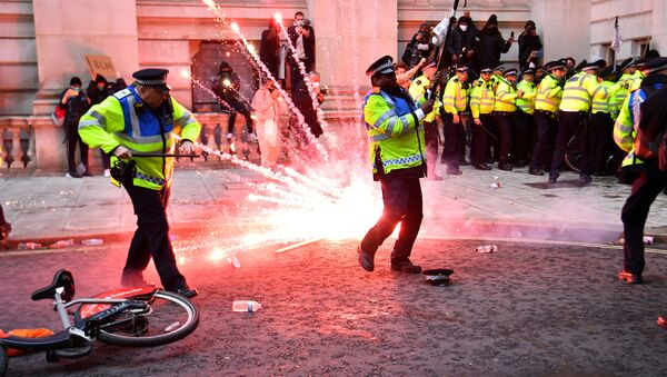 A firework explodes as police officers clash with demonstrators in Whitehall during a Black Lives Matter protest in London, following the death of George Floyd who died in police custody in Minneapolis, London, Britain, June 7, 2020.  - Sputnik Ελλάδα